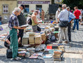 Lviv, Ukraine - July 2015: Men and women choose and buy, and sellers are selling old rare books and vintage items in the book mark Royalty Free Stock Photo
