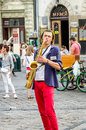 Lviv, Ukraine - July 2015: The musician plays the saxophone giving a concert in the Market Square in Lviv before the audience Royalty Free Stock Photo