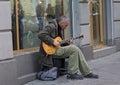 Lviv ukraine october street musician playing an electric guitar near a store window Stock Photo