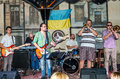 Lviv, Ukraine - September 2015: Musicians play the trumpet, guitar, piano and drums at the Lviv Café before the audience fans Royalty Free Stock Photo