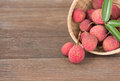 Lychee fresh lychees on wood background Royalty Free Stock Photos
