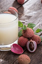 Lychee juice with fresh fruits on wooden background Royalty Free Stock Photo