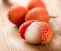 Lychee on a wooden table lichi closeup selective focus Stock Photos