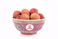 Lychees in bowl fresh a traditional chinese over white background Stock Images
