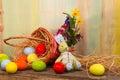 Lycklig påsk bunny painted eggs wicker basket Arkivbilder