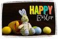 Lycklig påsk bunny toy basket painted eggs Royaltyfri Foto