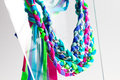 Lycra and chain necklaces fashion accessories very colourful made by weaving ribbons metal chains together Stock Photos