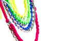Lycra and chain necklaces fashion accessories very colourful made by weaving ribbons metal chains together white background copy Royalty Free Stock Images