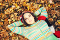 Lying in autumn forest Royalty Free Stock Image