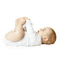 Lying baby looking up cute Royalty Free Stock Images