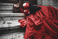 Lying and bleeding woman in Victorian dress Royalty Free Stock Photo