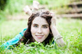Lying on grass pretty smiling girl Royalty Free Stock Photo