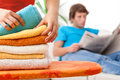 Lying towels after laundering young women colorful Royalty Free Stock Photo