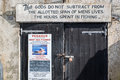 LYME REGIS, DORSET/UK - MARCH 22 : Quotation on a Garage Door at Royalty Free Stock Photo