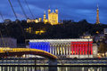 Lyon france november the historic courthouse of with the colors of flag with basilica of fourviere over the saone in Stock Image