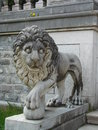Lyon guardian lion in front of peles castle in sinaia romania Stock Photos
