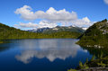 M gurr lake bella coola bc canada blue with reflection of clouds above mountains behind it Royalty Free Stock Image