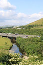 M motorway crossing river lune at tebay cumbria traffic on the in england there are carriageway closures with one lane coned off Stock Images