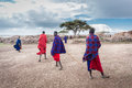 Maasai after finish welcome dance for tourists come back to relax in their place december ngorongoro tanzania Stock Photo