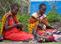 Maasai mara kenya december maasai women make traditional necklace december at maasai mara kenya the maasai are the most famous Royalty Free Stock Photo