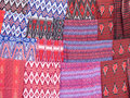 Maasai materials and fabrics with traditional patterns and designs sold on a local market Stock Images