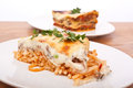 Mac and cheese bolognese bake lasagna with beef tomato with beef lasagna at the back Stock Images