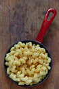 Mac and cheese with spices in red pan Stock Photos