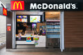 Mac donalds kiosk on bts skytrain station bangkok thailand may with timber facad showing drinks food and ice cream Royalty Free Stock Photos