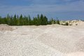Macadam of fine gravel hills against the sky Royalty Free Stock Photo