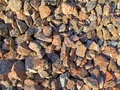 Macadam multicolored gravel in the bright sun Stock Images