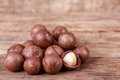 Macadamia nuts brown seed on wooden background Stock Image
