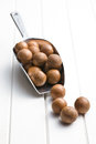 Macadamia nuts on scoop white wooden table Stock Photography