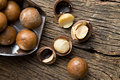 Macadamia nuts on scoop wooden table Royalty Free Stock Image