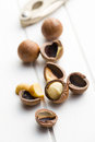 Macadamia nuts on white wooden table Stock Images