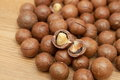 Macadamia nuts on a wooden table Royalty Free Stock Image