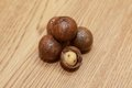 Macadamia nuts on a wooden table Royalty Free Stock Images