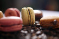 Macaron and coffee beans beige as background Stock Photo