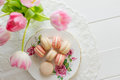 Macaron on a porcelain plate seven french macarons pronounced macaroon popular buttercream filled meringue type cookie or biscuit Royalty Free Stock Photo