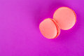 Macaron top view of tasty pink macaroons on pink background Royalty Free Stock Image