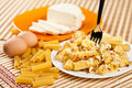 Macaroni with cheese and recipe ingredients Royalty Free Stock Photo