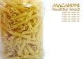 Macaroni jar full of glass on white background Royalty Free Stock Photo