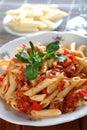 Macaronis avec l'air et le tomatoe Photographie stock libre de droits