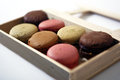 Macarons in a box coloured on wooden Royalty Free Stock Photo