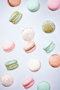 Macarons cake, top view flat lay, fly falling macaroon background Royalty Free Stock Photo