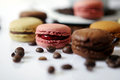 Macarons and coffee beans some for breakfast Royalty Free Stock Photo