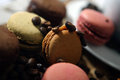 Macarons and coffee beans on a wooden trencher Royalty Free Stock Photo