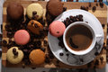 Macarons and coffee beans on a wooden trencher Stock Photos