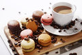 Macarons and coffee beans on a wooden trencher Stock Images
