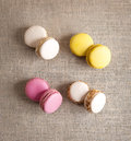 Macarons of different colors on sacking background Royalty Free Stock Images