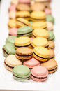 Macarons different flavors of on a serving plate Royalty Free Stock Image